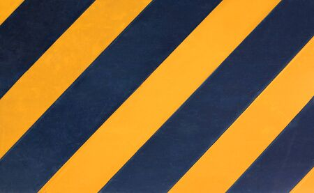Yellow and black diagonal stripes texture background. 写真素材