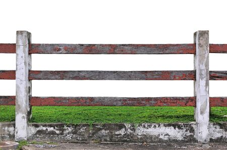 Old wood fence in garden with plant isolated on white background.