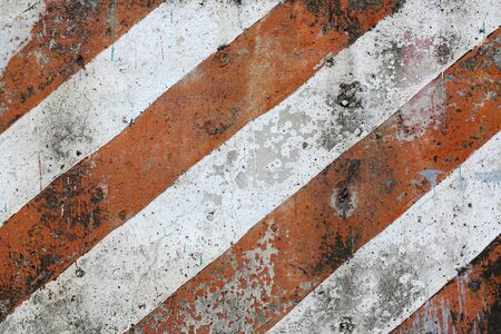 Old and dirty red and white diagona hazard stripes seamless texture