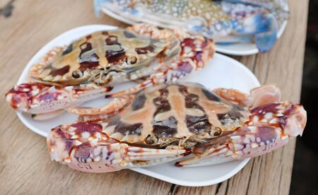 Fresh red horse crab on white plate