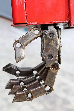 Metal hand of Robot. Robot parts.