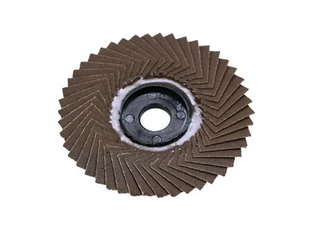 Abrasive disk for grinder on white background.
