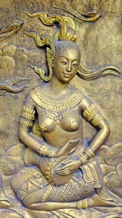Native culture Thai sculpture on the temple wall