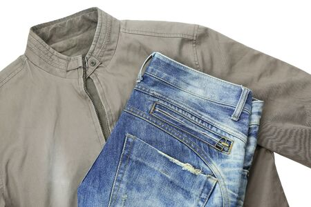 Blue jeans and brown jacket isolated on white background