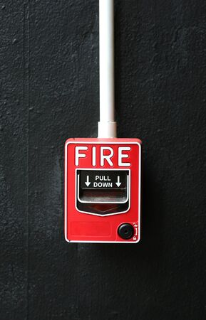 Fire alarm on black wall