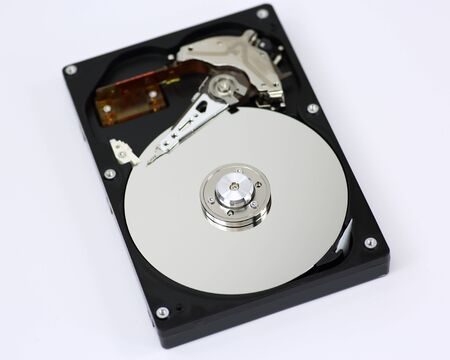 Harddisk drive (HDD) with top cover open isolated on white background Foto de archivo