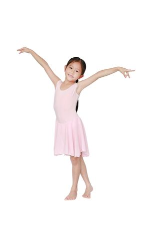 Happy Asian ballet dancer girl in pink tutu skirt isolated on white background. Little child girl dreams of becoming a ballerina.