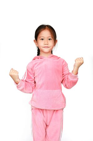 Cute little Asian child girl in pink tracksuit or sport cloth with fight stance isolated on white background. Portrait half-length of kid girl. Confident concept.