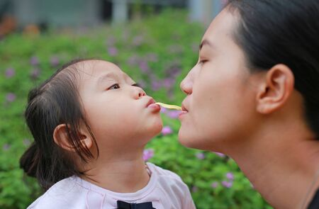 Mother and child girl playing bubble gum. Happy loving family.