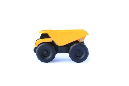 The yellow toy car heavy truck isolated on white background.