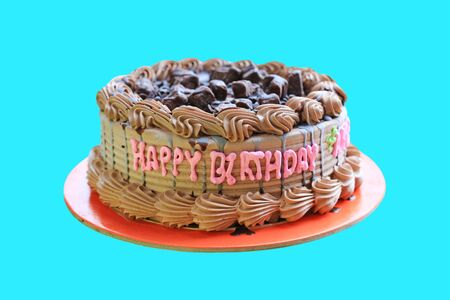 Chocolate cake with text happy birthday isolated on cyan background. Фото со стока - 135367742