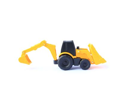 The yellow toy car Bulldozer-Excavator isolated on white background. Children's backhole toy model. Reklamní fotografie