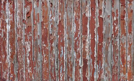 Cracked old brown paint on wood plank wall background. Фото со стока - 135367890
