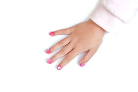 Children nails with fashion jewels isolated on cyan background. Close up shot. Фото со стока - 135367715