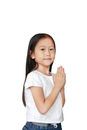 Little asian kid girl praying isolated on white background with copy space. Sawasdee is meaning hello. 스톡 콘텐츠