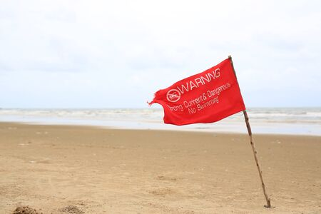 Red flag Warning Strong Current and Dangerous No Swimming in sea on Storm. Red flag flying on beach
