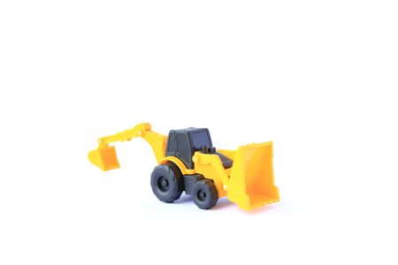 The yellow toy car Bulldozer-Excavator isolated on white background. Children's backhoe toy model.