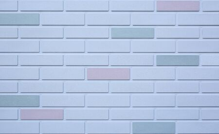 Background of white brick wall with some different color. Фото со стока