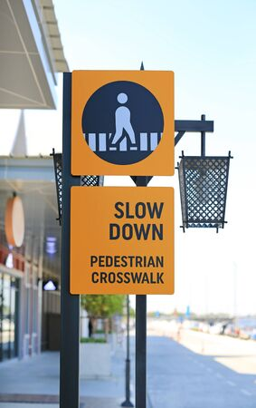 Slow down pedestrian crossing road label Sign.