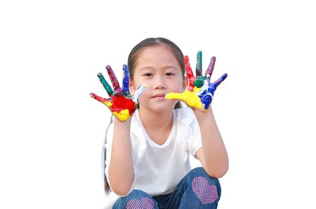 Playful little girl with colorful hands paints isolated over white background. Focus at kid hands.