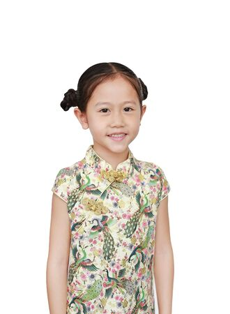 Happy little Asian girl wearing cheongsam with smiling over white background. Happy Chinese New Year.
