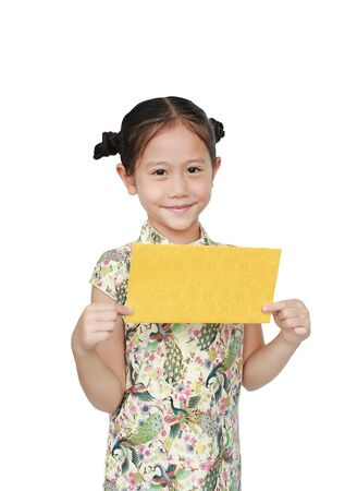 Beautiful Asian little girl in traditional cheongsam with holding gold envelope for happy Chinese New Year isolated on white background.