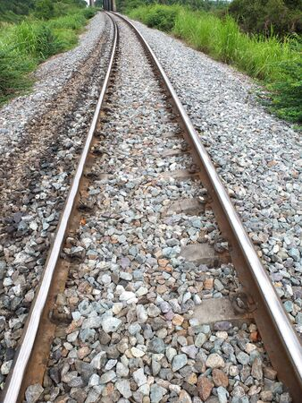 Steel support rails with concrete sleepers strewn with gravel