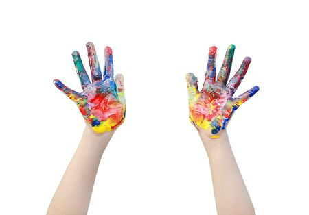 Close up kid hands painted in colorful paints isolated over white background. Фото со стока