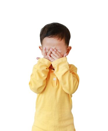 Little Asian baby boy covering eyes with hands isolated over white background.