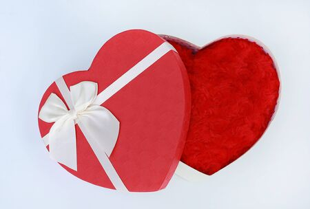 Opened cover Red heart gift box on white background.