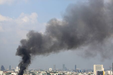 Air pollution with black smoke floating in bangkok city.