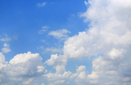 Blue sky and fluffy clouds background.