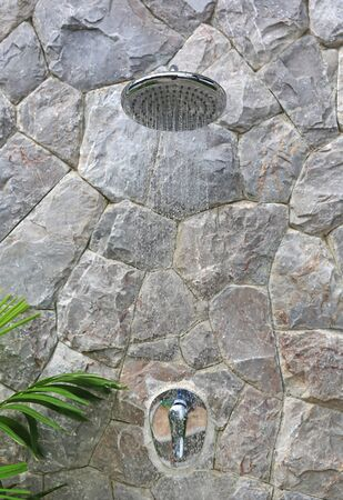 Outdoors shower behide Swimming pool