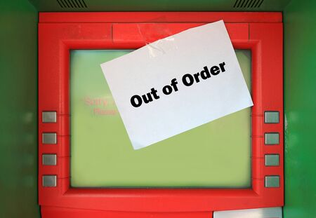 out of order text on white paper with stick on ATM.  Sorry ATM. out of service on screen