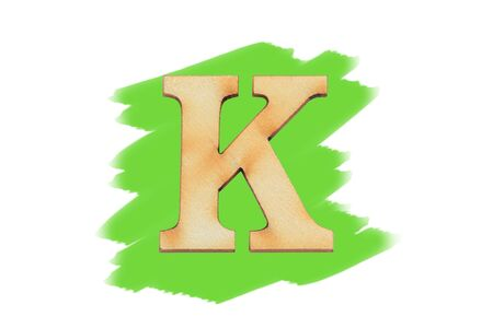Alphabet letter wooden font on painted color green isolated on white background. English flat wood character K. Stock fotó