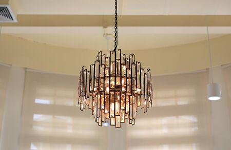 Crystal chandelier hanging from ceiling. Reklamní fotografie
