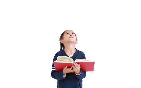 Portrait of asian girl casual school uniform holding open book with looking up isolated over white background in studio shot. Education concept