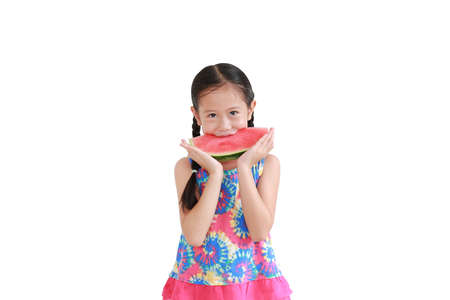 Asian little child girl eating watermelon isolated on white background Foto de archivo