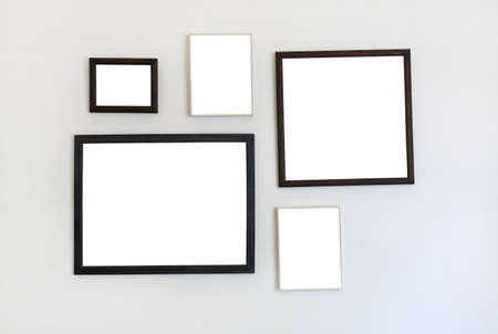 Frame of empty image on white wall background.
