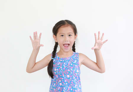 Cheerful asian little child girl peekaboo expression. Kid posture open hands isolated on white background.
