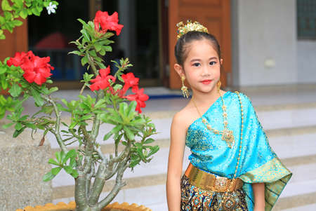Beautiful asian little child girl wearing traditional thai style dress.