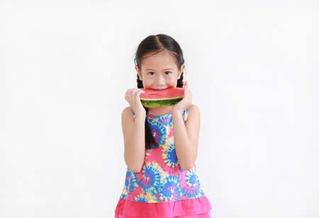 Portrait asian little kid girl eating watermelon isolated on white background Archivio Fotografico