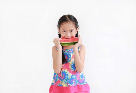 Portrait asian little kid girl eating watermelon isolated on white background 版權商用圖片