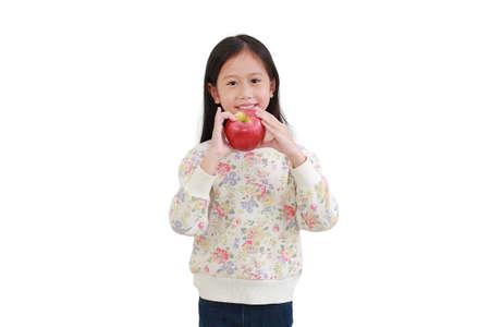 Little asian girl eating red apple over white background 版權商用圖片