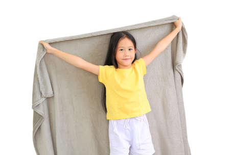 Smiling asian little child girl cover head with gray blanket isolated on white background. winter season concept