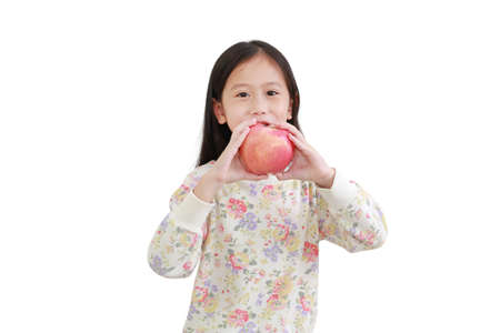 Smiling little asian girl holding red apple on white background