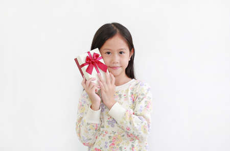 Asian little child girl with gift box on white background 版權商用圖片