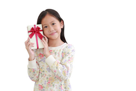 Cute little asian kid girl holding gift box on white background. with clipping path