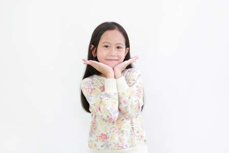 Beautiful asian little child girl apply face full of talcum powder over white background