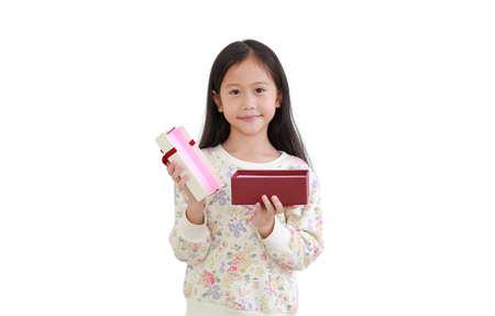 asian little girl while open gift box on white background. 版權商用圖片